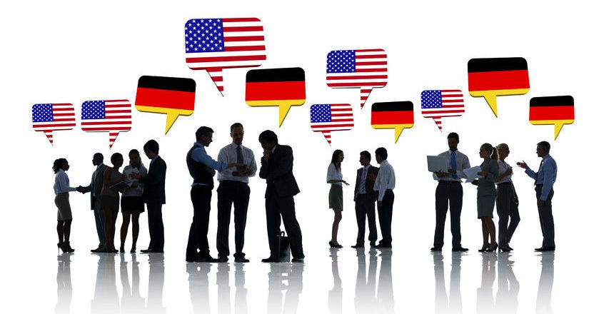 28862395 - group of american and german business people talking to each other in a white background